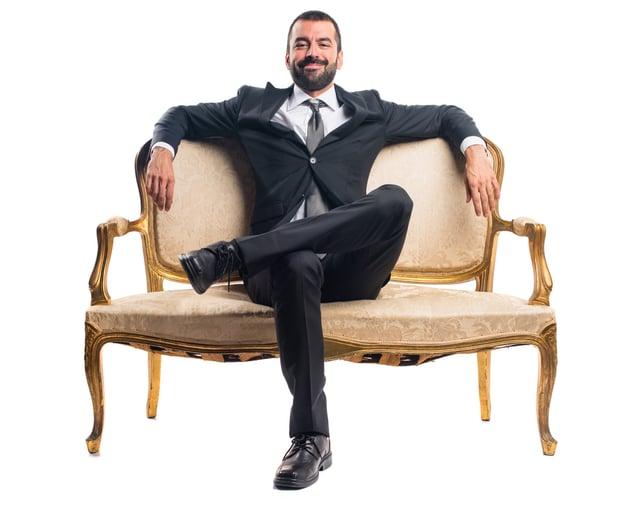 businessman-sitting-armchair